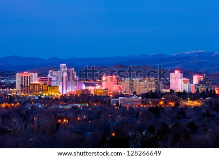 RENO - FEBRUARY 9: Reno skyline on February 9, 2013. It's known as The Biggest Little City in the World, famous for casinos and is the birthplace of the gaming corporation Harrah's Entertainment. - stock photo