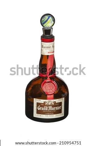 RENO, NEVADA - AUGUST 12, 2014: A bottle of Grand Marnier liqueur from France with a fancy glass stopper. Grand Marnier is an orange-flavored cognac created by Benedictine monks in the 19th century. - stock photo