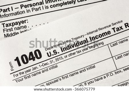 RENO, NEVADA - JANUARY 21, 2016: U.S. income tax form 1040 required of all American citizens who had any earned income in 2015 - stock photo