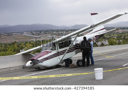 RENO, NEVADA - MAY 24, 2016:  A single engine Cessna aircraft crash lands on a highway after suffering catastrophic engine failure.  No reported injuries. FAA and NTSB investigating.