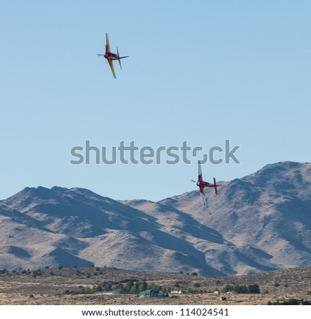 RENO, NEVADA -Â?Â? SEPTEMBER 16:  Gibson (232) chasing Dawson (77) during the finals in the Breitling Gold Medal race at the National Championship Air Races on September 16, 2012 near Reno, Nevada.