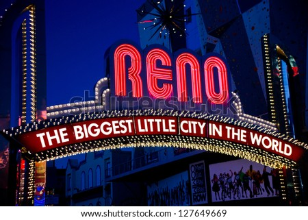 RENO, NEVADA - SEPTEMBER 10, 2012: The landmark arch welcomes visitors to downtown Reno, Nevada. The original arch was built in 1926. Reno, Sept. 10, 2012. - stock photo