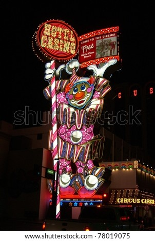 RENO - SEPTEMBER 20 : Circus Circus Hotel and Casino clown neon sign at night on famous Virginia Street on September 20, 2008 in Reno, NV. This property opened in 1978 and features live circus acts. - stock photo