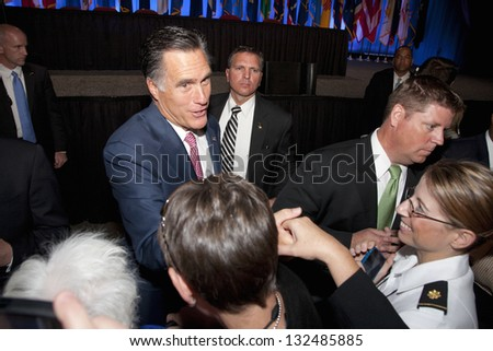 RENO - SEPTEMBER 11: Mitt Romney shakes hands with supporters at the annual meeting of the National Guard Association on September 11, 2012 in Reno, Nevada. - stock photo