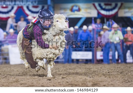 RENO , USA - JUNE 27 : Cowboy Participant in a Bull riding Competition at the Reno Rodeo  a Professional Rodeo held in Reno Nevada , USA on June 27 2013  - stock photo