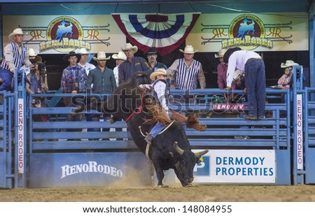 RENO , USA - JUNE 30 : Cowboy Participant in a Bull riding Competition at the Reno Rodeo  a Professional Rodeo held in Reno Nevada , USA on June 30 2013  - stock photo