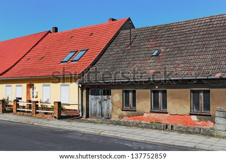 Renovated and unrenovated - stock photo