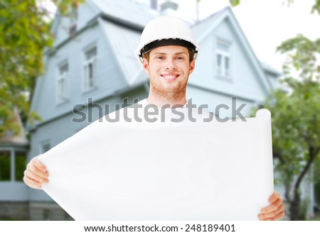 renovation, building, people and home concept - male builder or architect in helmet holding blueprint over living house background - stock photo