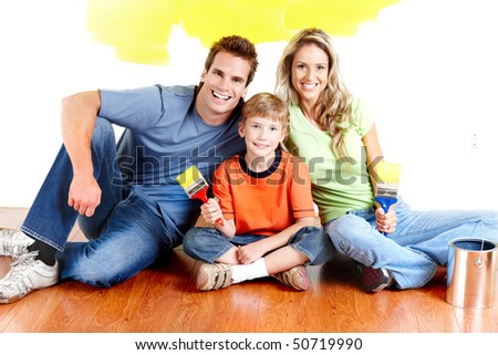 Renovation. Young family painting interior wall of home. - stock photo
