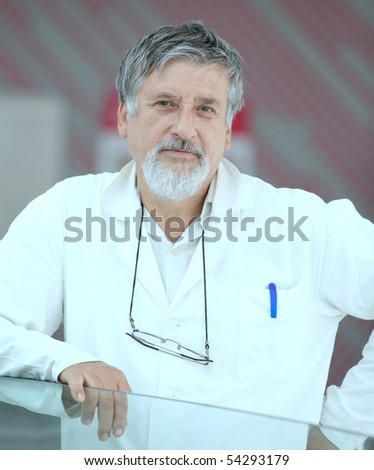 Renowned scientist/doctor in a research center/hospital looking confident - stock photo
