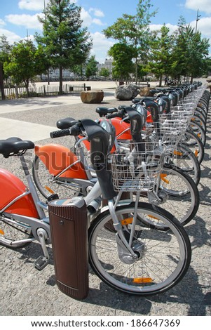 Rent a bike in city, public transportation - stock photo
