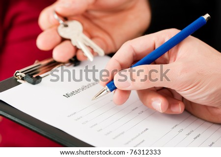 Rent an apartment - Filling Tenants self-disclosure; close-up on form - stock photo