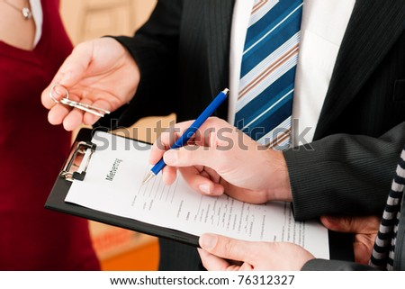 Rent an apartment - Signing tenant agreement; close-up on form - stock photo