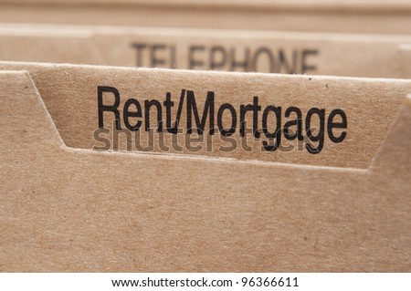 Rent Mortgage section tab in folding file. - stock photo