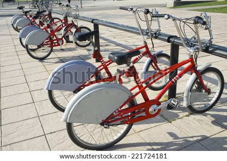 Rental bicycles parked, Zaragoza, Spain. - stock photo