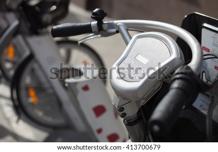 Rental bike pickup location in the city.Great way to take bicycle for ride cheap.Pay with credit card, use terminal computer on handlebar to take parked vehicle. Easy, healthy urban transport - stock photo