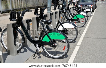Rental cycles for public use in urban setting - stock photo