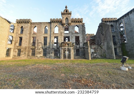 Renwick Smallpox Hospital, an abandoned hospital located in an otherwise undeveloped area at the southern tip of the Roosevelt Island in Manhattan, New York City. - stock photo