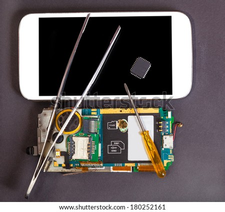 repair and maintenance of mobile devices, electronics background - stock photo
