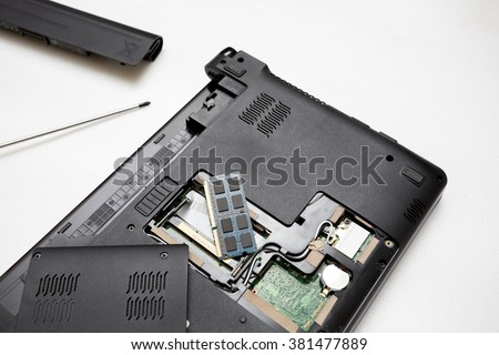 Repair computer notebook on white background,Computer laptop broken,RAM of computer notebook. - stock photo