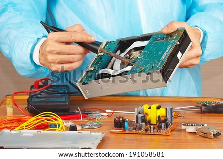 Repair electronic board with a soldering iron in the service workshop
