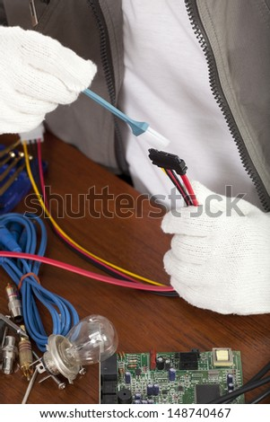 Repair man engineer cleaning computer wire stock photo 148740467 repair man engineer cleaning computer wire part on work table greentooth Image collections