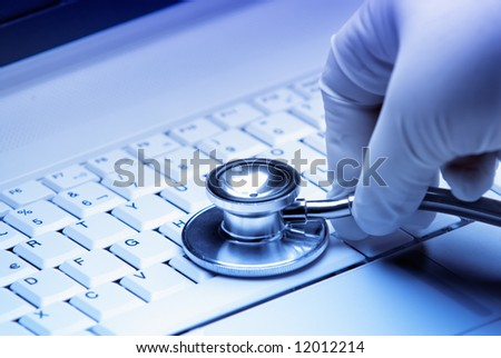 Repair of computer  by a surgeon medic, good technical support symbol. - stock photo
