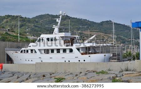 repair of marine yachts in the Marina Degli Aregai, San Bartolomeo al Mare, Italy - stock photo