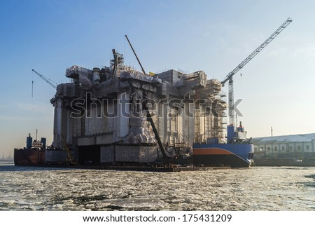 Repair of oil rig in the frosty sunrise in the shipyard of Gdansk - Poland - stock photo