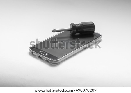 repair of smart-phone with a screwdriver and the screw