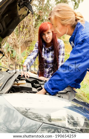 repair of the broken car - stock photo