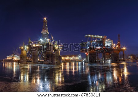 Repair of the oil rig in the shipyard. - stock photo