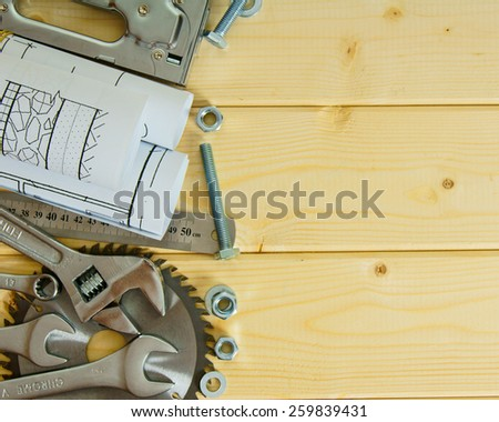 Repair planning. Repair work. Drawings for building and many metal working tools on wooden background.  - stock photo