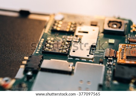 Repair smartphone. Disassembled parts on a smartphone. Close-up. - stock photo
