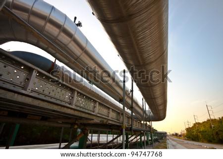 repair steam line in factory - stock photo