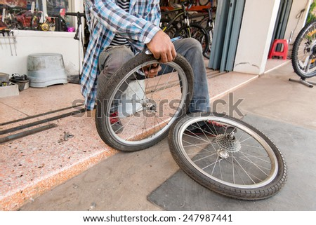 Repairing a flat tire of an bicycle tire - stock photo