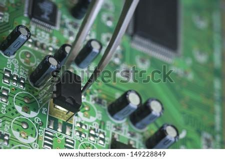 Repairing Circuit Board - stock photo