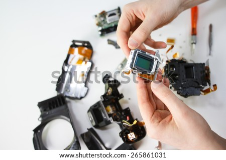 Repairing digital single lens reflex camera, isolated. - stock photo
