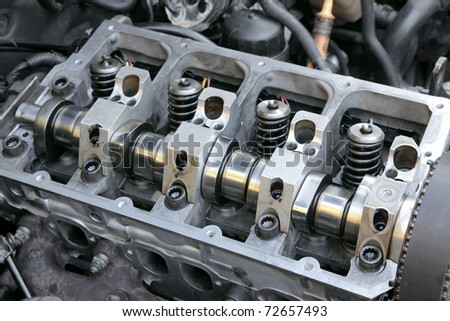 Repairing of modern diesel engine closeup of camshaft and valves - stock photo