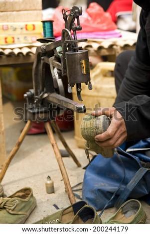 Repairing shoes  - stock photo