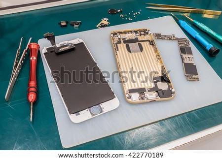 Repairing Smart Phone on Desk, Selective Focus - stock photo