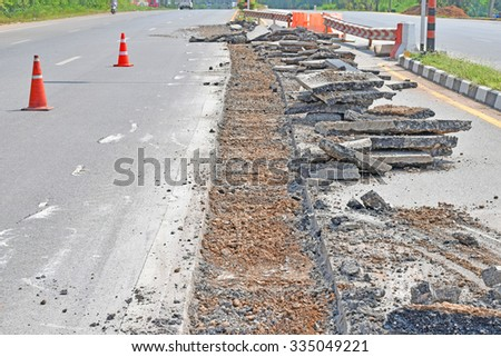 Repairing the asphalt pavement on the road. - stock photo