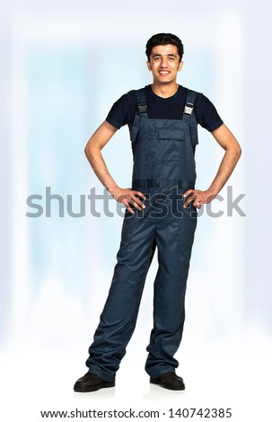 Repairman Arab nationality in the construction overalls - stock photo