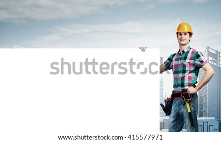 Repairman demonstrating banner - stock photo
