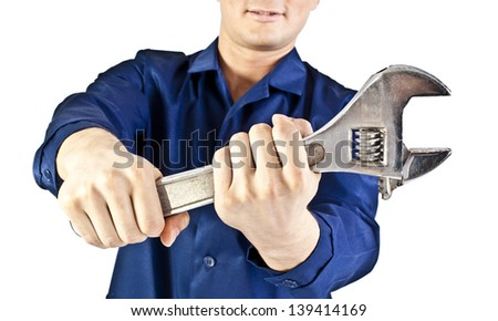 Repairman hand with wrench isolated on white - stock photo