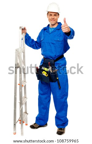 Repairman holding ladder and showing thumbs up gesture isolated on white