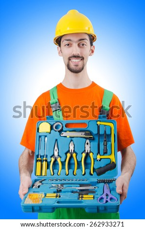 Repairman in coveralls in industrial concept - stock photo