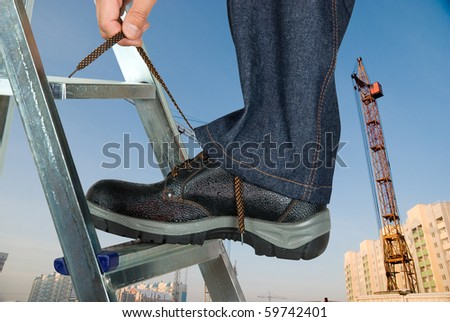 repairman lace his shoes on building background