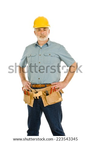 Repairman With Toolbelt  And Hard Hat/ Vertical Shot/ On White - stock photo