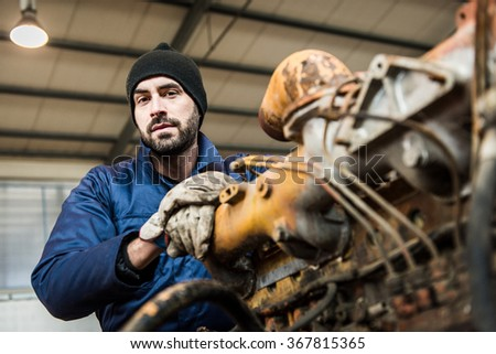 repairman worker repairing a engine excavator